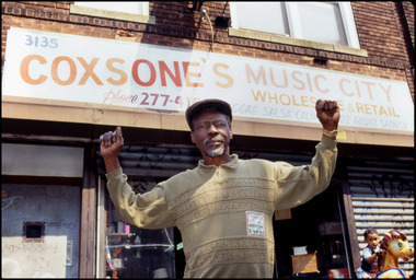 Clement 'Coxsone' Dodd outside his Brooklyn record shop and studio 8-19-1992